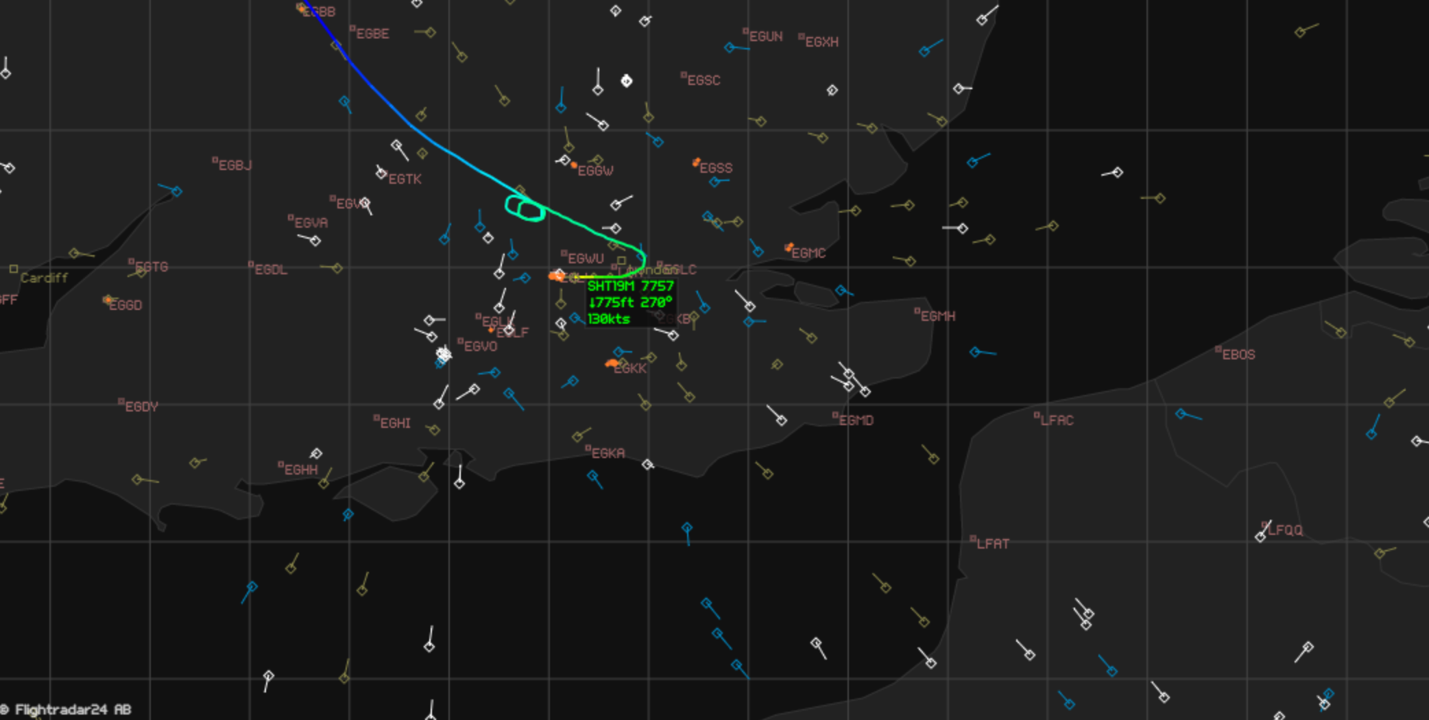 A screen shot from FlightRadar24 Premium shows planes in the sky over London. The green line represents the plane whose path we followed.