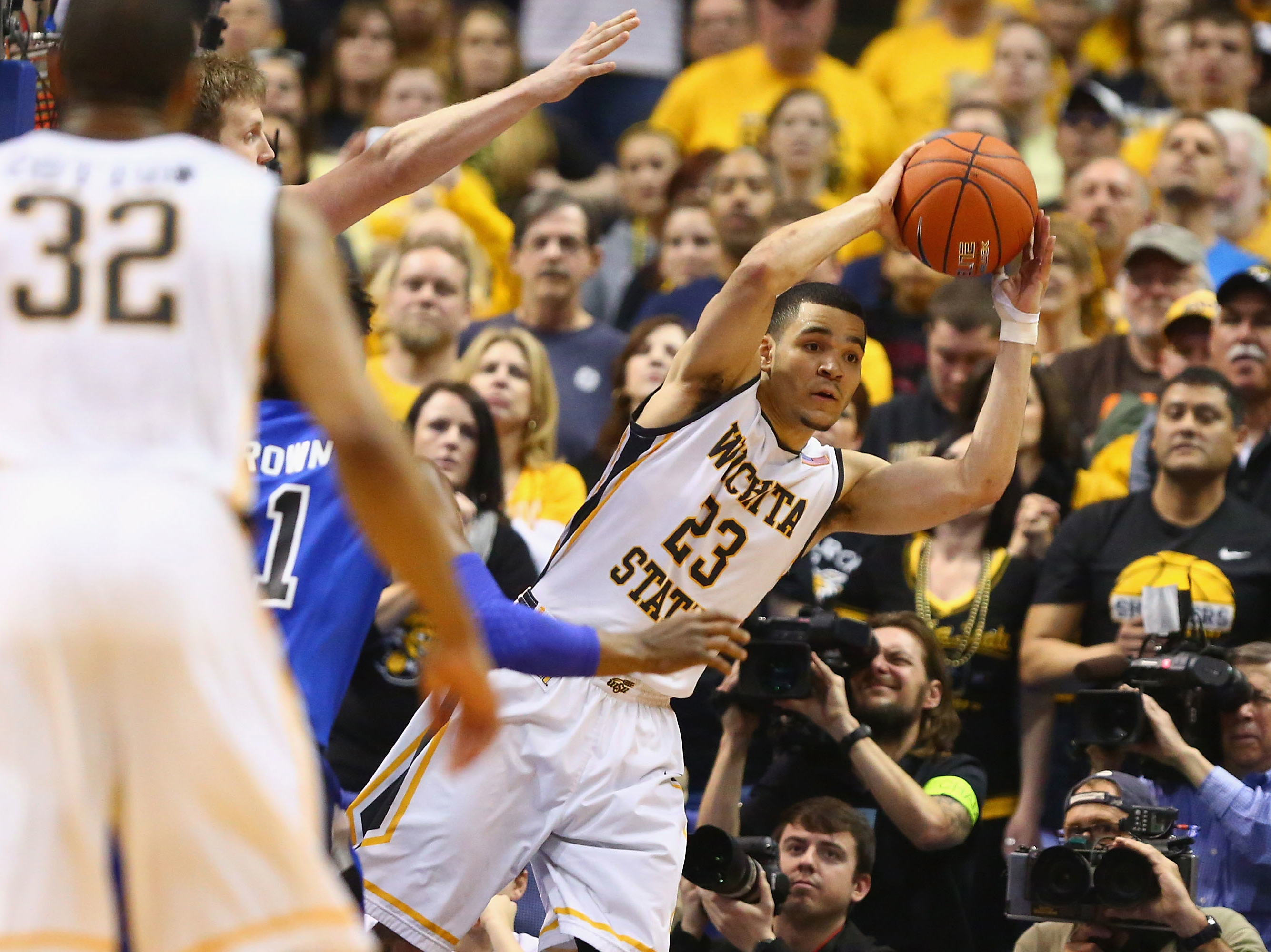 Fred VanVleet of Wichita State looks to pass the ball during the 2014 Missouri Valley Conference basketball tournament.