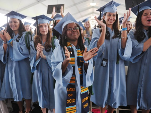 graduating students applaud as us president barack obama speaks during commencement ceremonies at barnard college may 14 2012