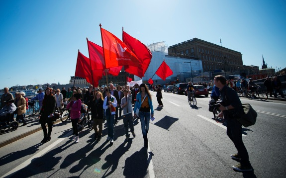 Protesters march during a May Day rally