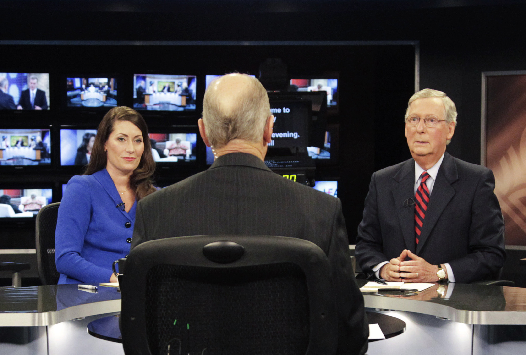 Republican U.S. Senate Minority Leader McConnell and Democratic U.S. Senate candidate Grimes prepare for their debate at the Kentucky Education Television network headquarters in Lexington