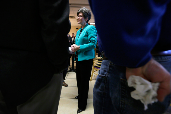 Republican Senate candidate Joni Ernst talks with supporters during a campaign stop Monday, Nov. 3, 2014, in Ankeny, Iowa.