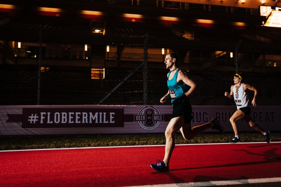 Canadian Corey Gallagher heads down the straight away trailed closely by Australian Jack Colreavy at the Flotrack Beer Mile World Championships in Austin