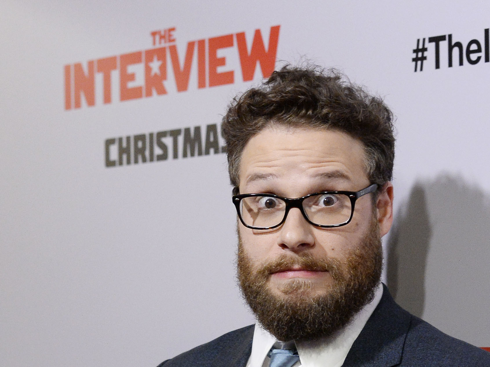 """Seth Rogen poses during premiere of """"The Interview"""" in Los Angeles"""