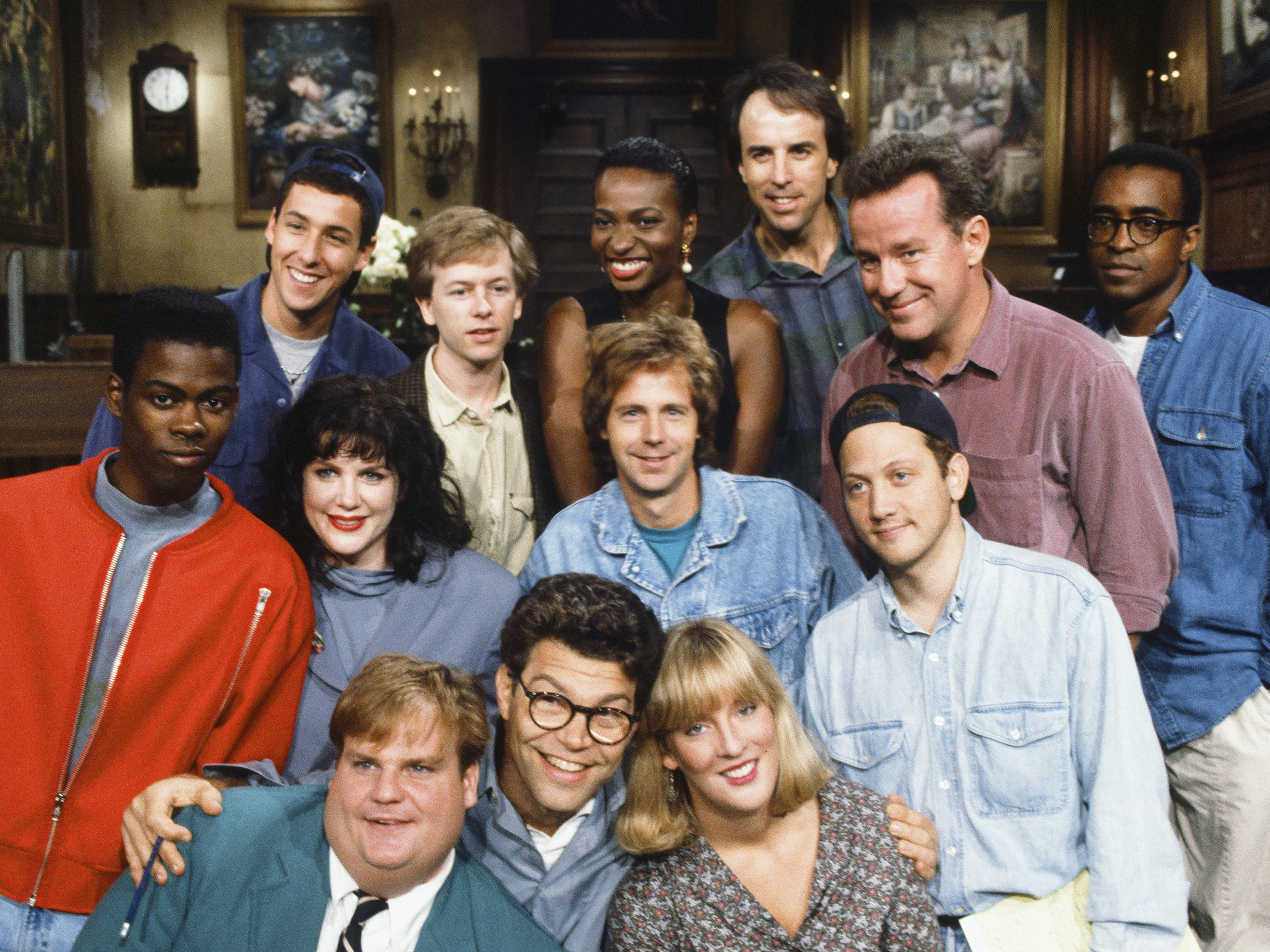 Saturday Night Live, Season 18 cast; pictured (back row left to right): Adam Sandler, David Spade, Ellen Cleghorne, Kevin Nealon, Phil Hartman, Tim Meadows (2nd row) Chris Rock, Julia Sweeney, Dana Carvey, Rob Schneider (front row l-r) Chris Farley, Al Franken and Melanie Hutshell.