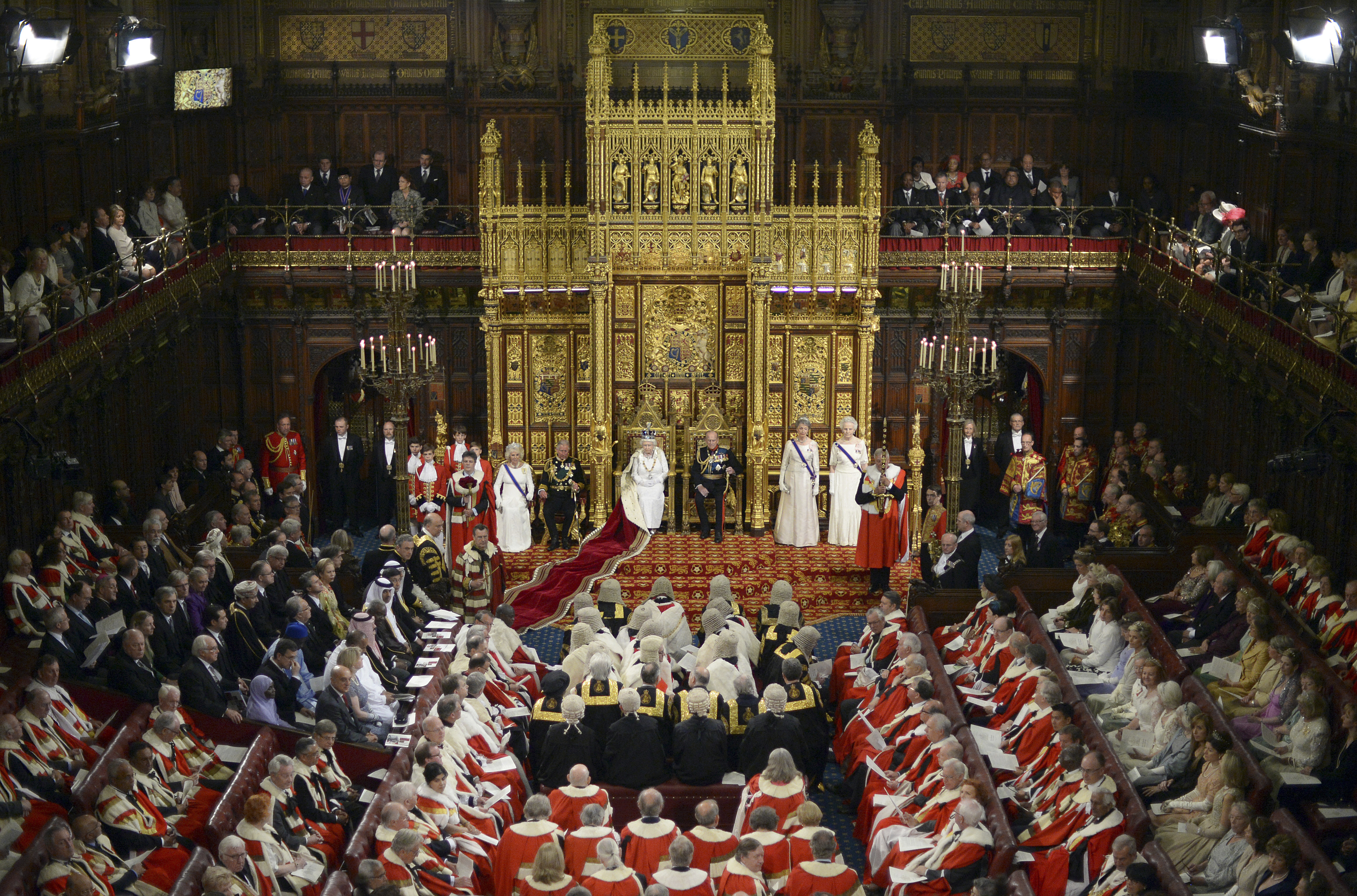 Queen Elizabeth II prepares to deliver her speech in the House of Lords during the State Opening of Parliament at the Palace of Westminster in London Wednesday, June 4, 2014.
