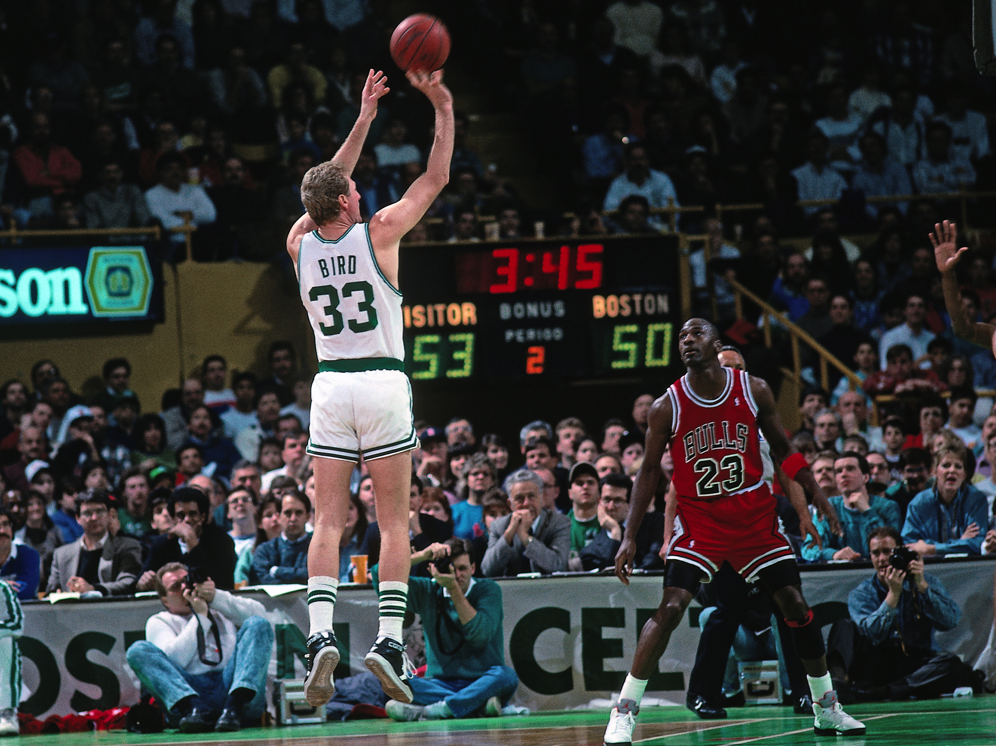 Larry Bird of the Boston Celtics shoots against Michael Jordan of the Chicago Bulls during a game in 1990 at the Boston Garden in Boston.