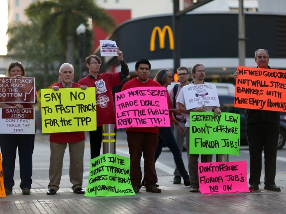 Labor Activists Protests Outside Treasury Secretary's Lew Talk At Miami Dade College