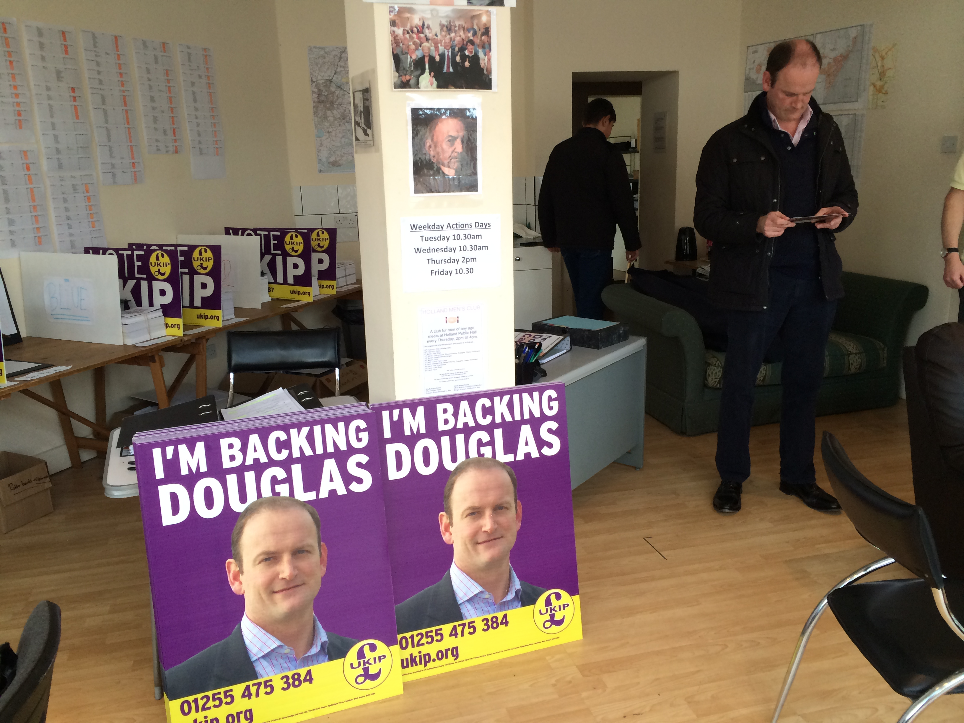 UKIP candidate Douglas Carswell looks at one of his campaign leaflets in his campaign HQ on Leas Road in Clacton, England.