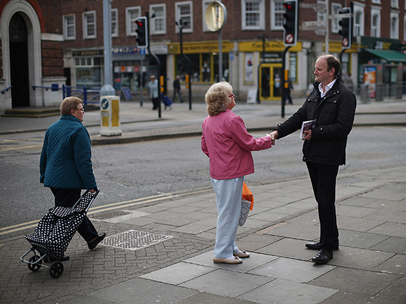 UKIP candidate Douglas Carswell meets with a local supporter on April 8, 2015, in Clacton-on-Sea, England.