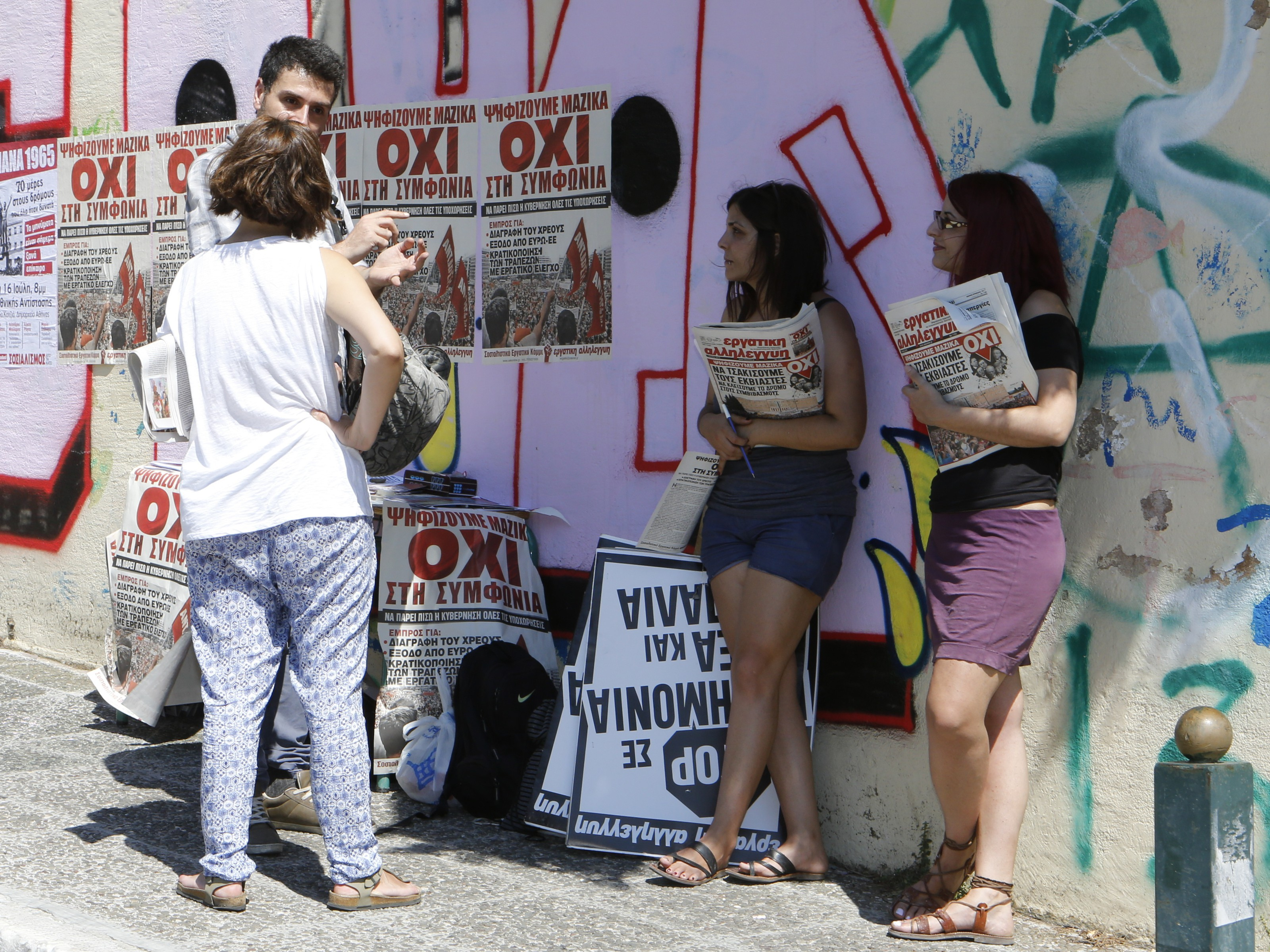 'Oxi'  (Greek for no) campaigners have a stall near a