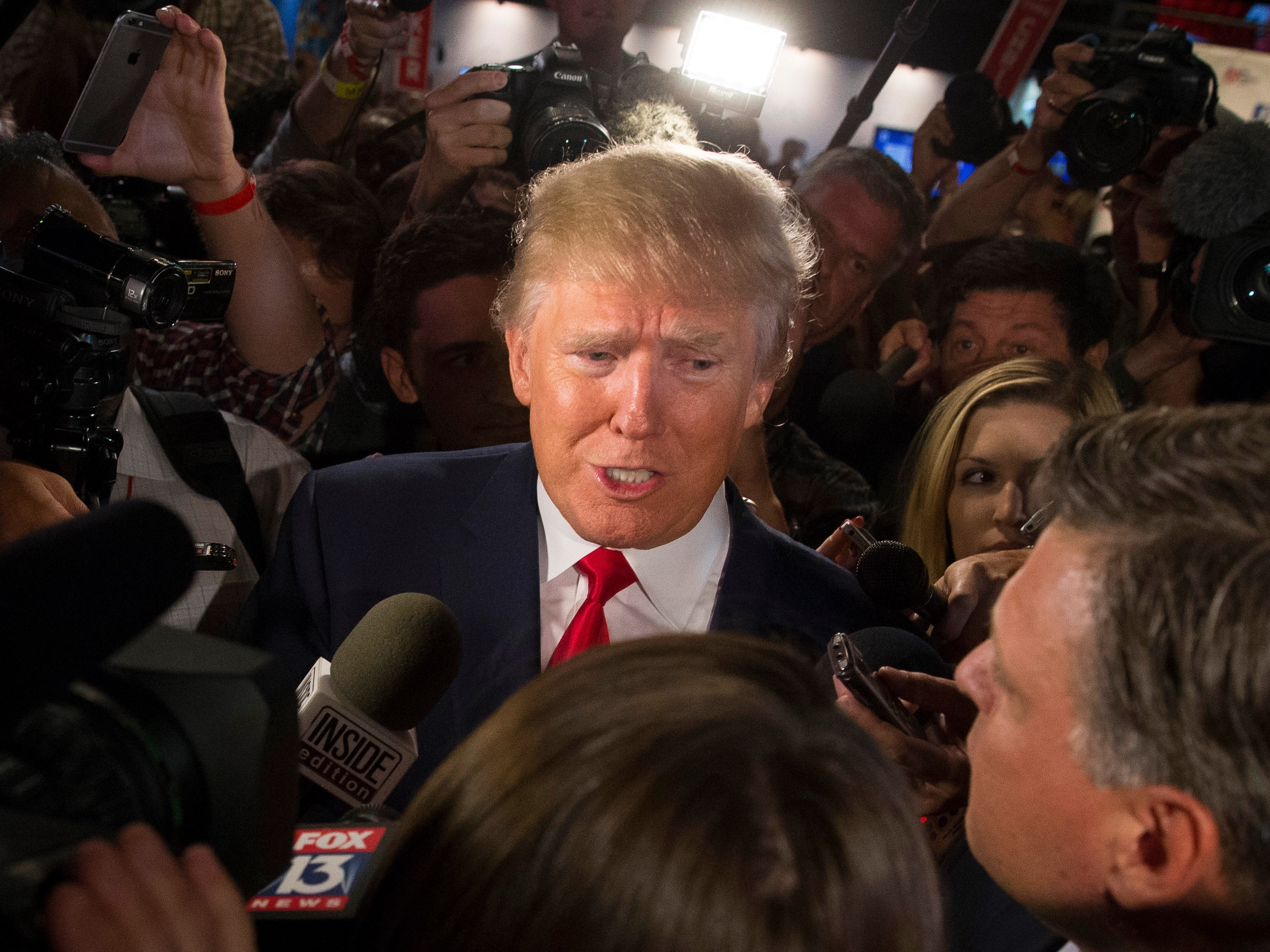 Republican presidential candidate Donald Trump speaks to the media in the spin room after the first Republican presidential debate, held Thursday in Cleveland.