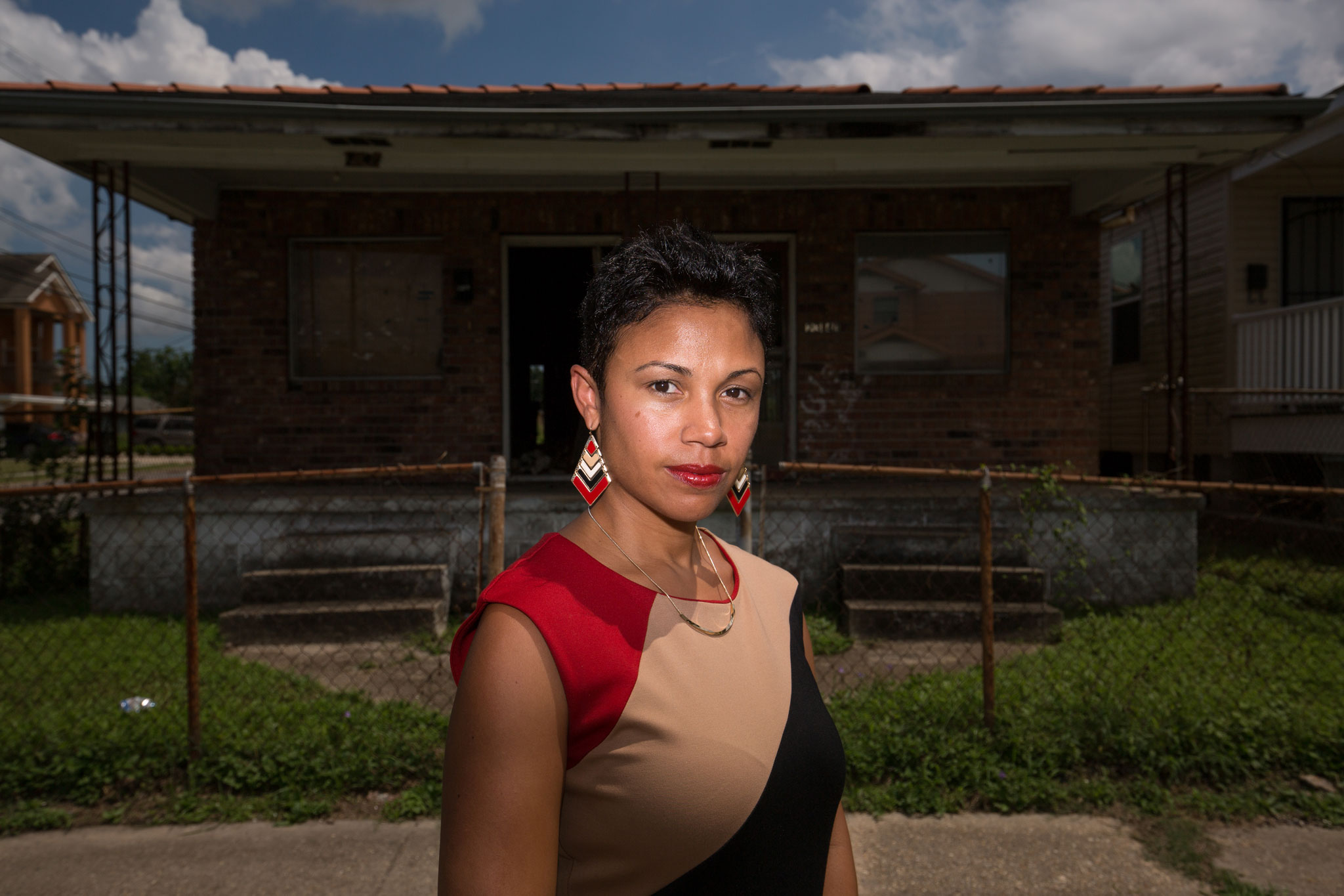 Erika McConduit-Diggs, president of the Urban League of Greater New Orleans, in front of a home in the Upper Ninth Ward.