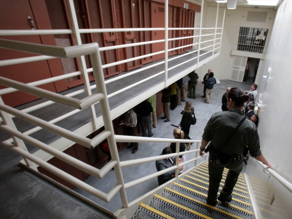 Reporters examine a two-tiered cell pod at the Pelican Bay State Prison in California in 2011.