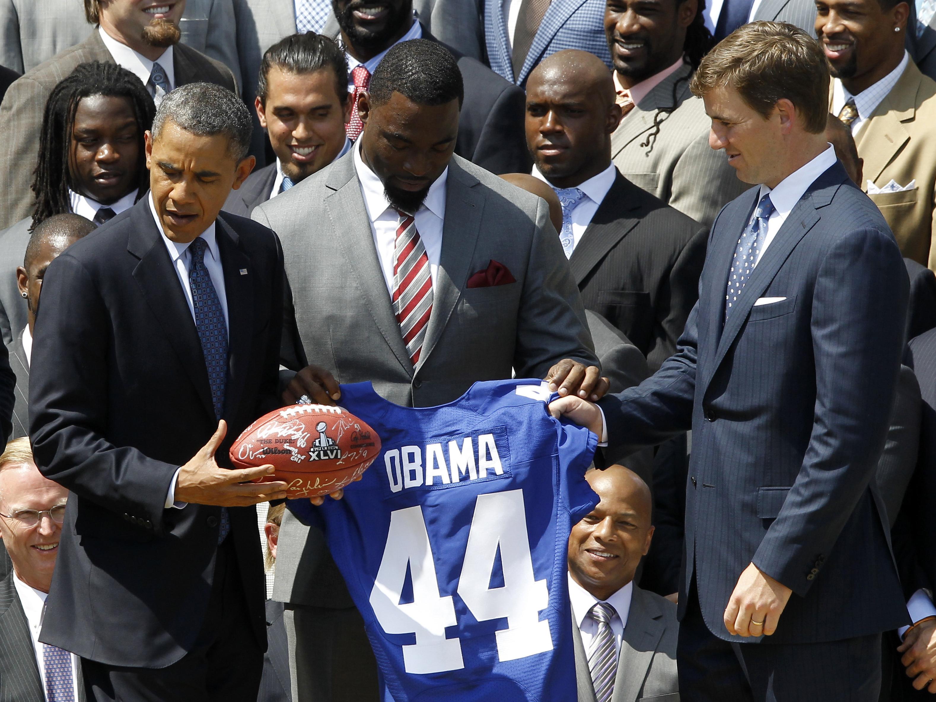 Barack Obama, Tom Coughlin, Zak DeOssie, Justin Tuck, Eli Manning