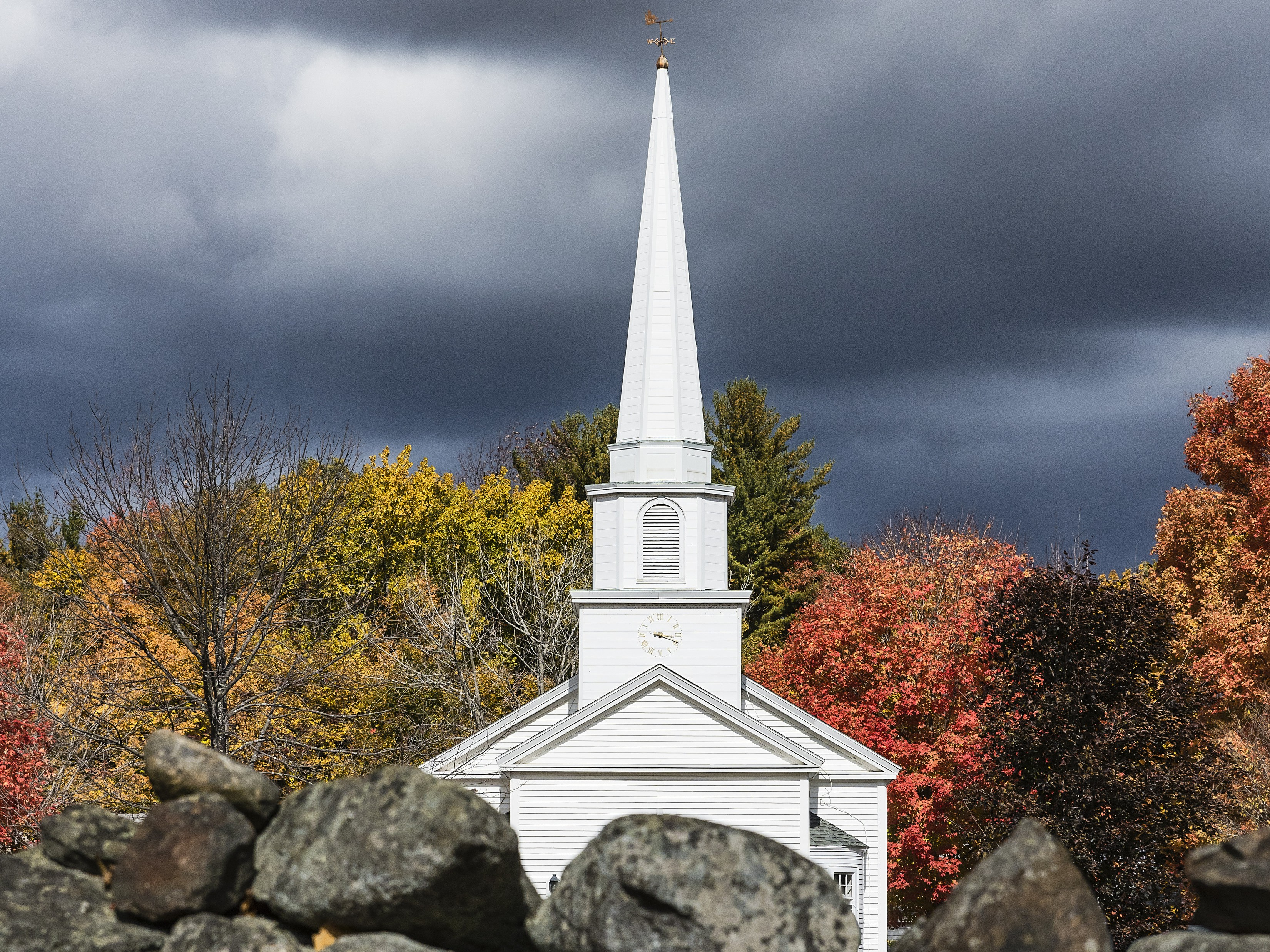 Charming New England church and stone wall in the village of