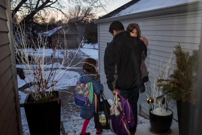 Nick Sarcone takes his two daughters, Lydia and Bianca, to school on Jan. 13.