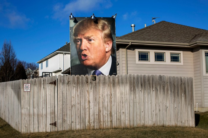 A photograph of Donald Trump along a busy street in West Des Moines, Iowa, on Jan. 15.