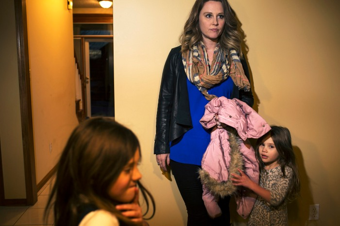 Betsy Sarcone, a realtor, with her two daughters, Lydia, left, and Bianca, showing a house.
