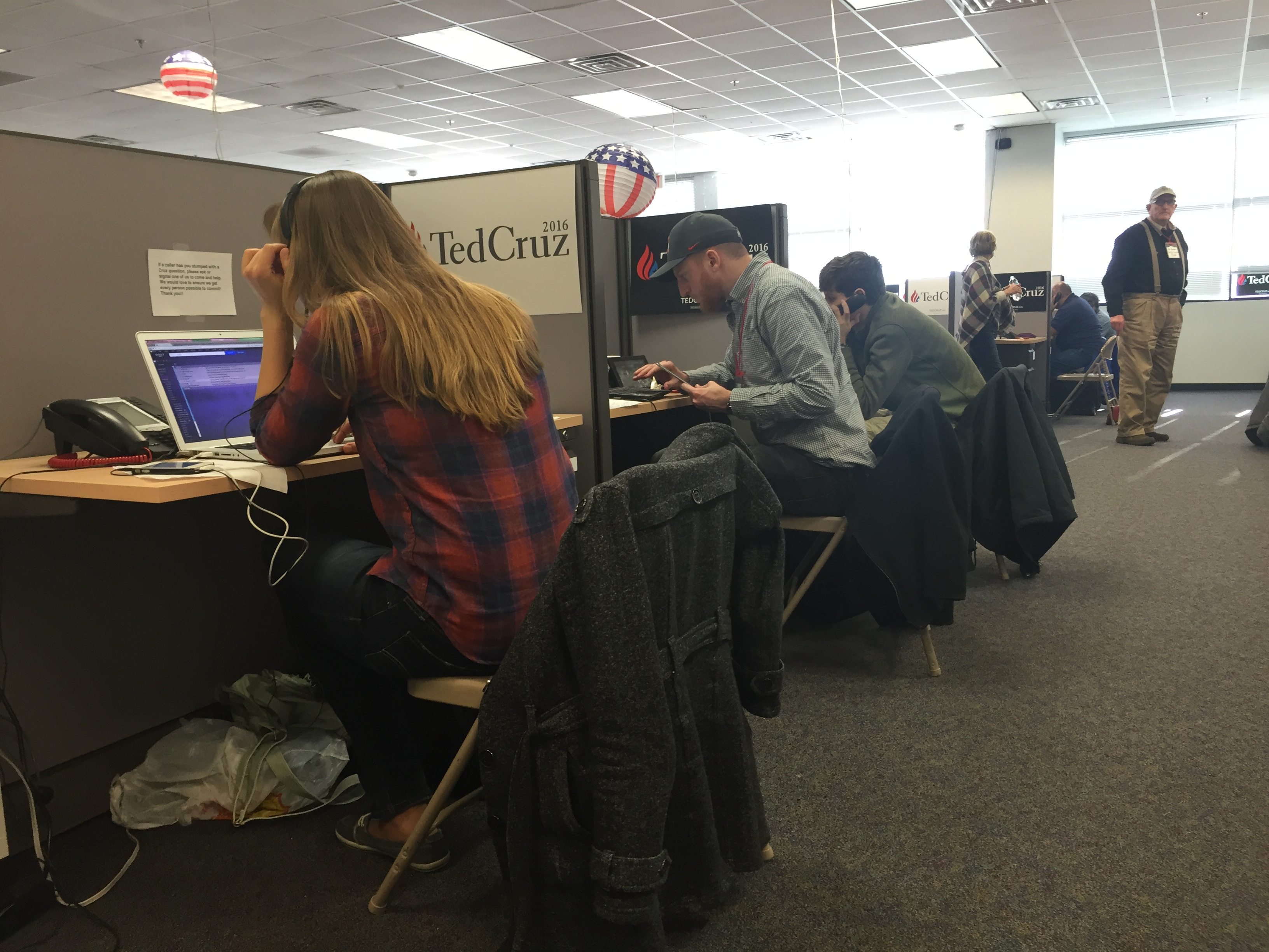 Volunteers make phone calls at Ted Cruz field office outside of Des Moines, IA.
