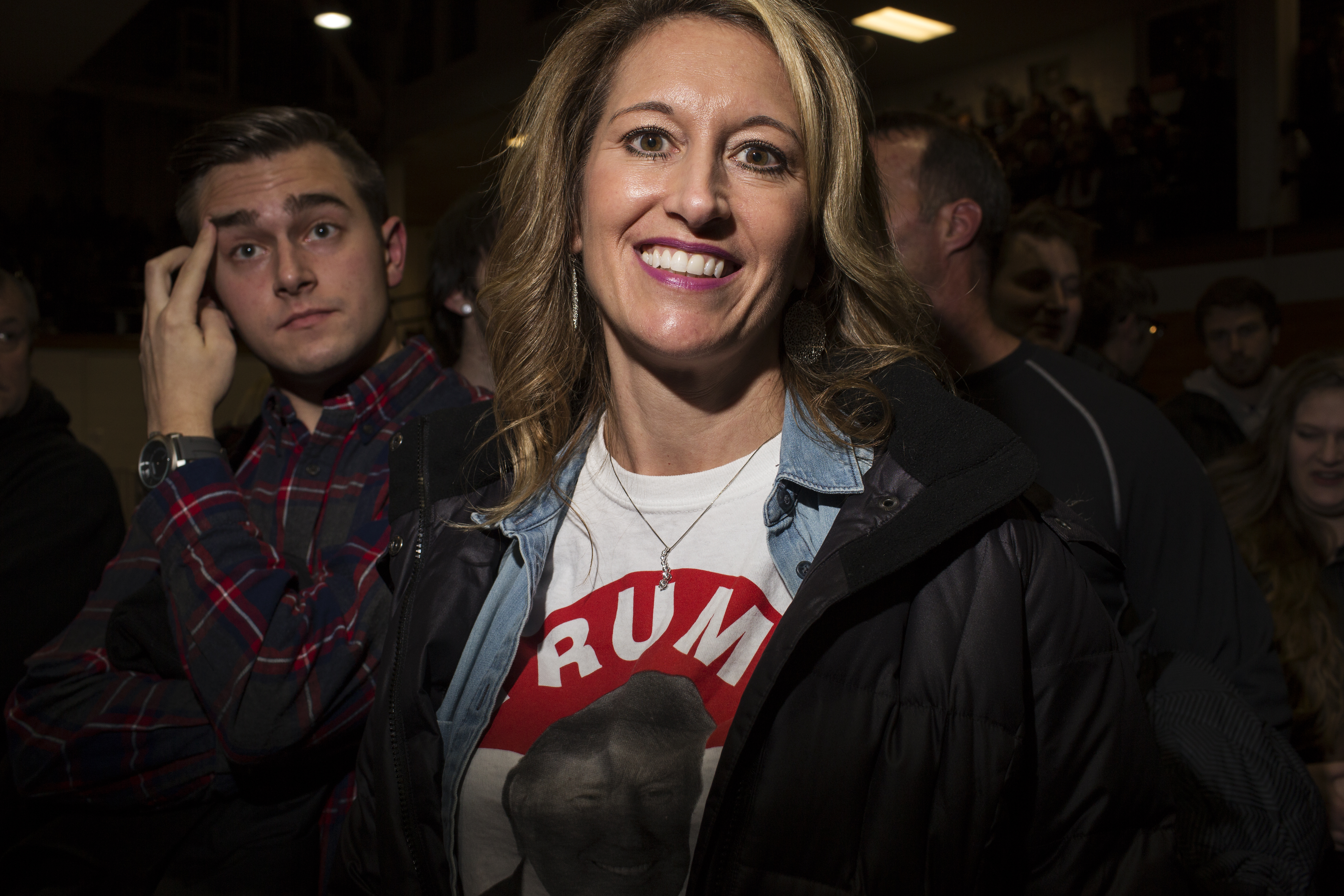 Christie Saunes waits in the crowd for the start of Donald Trump's rally at the University of Northern Iowa.