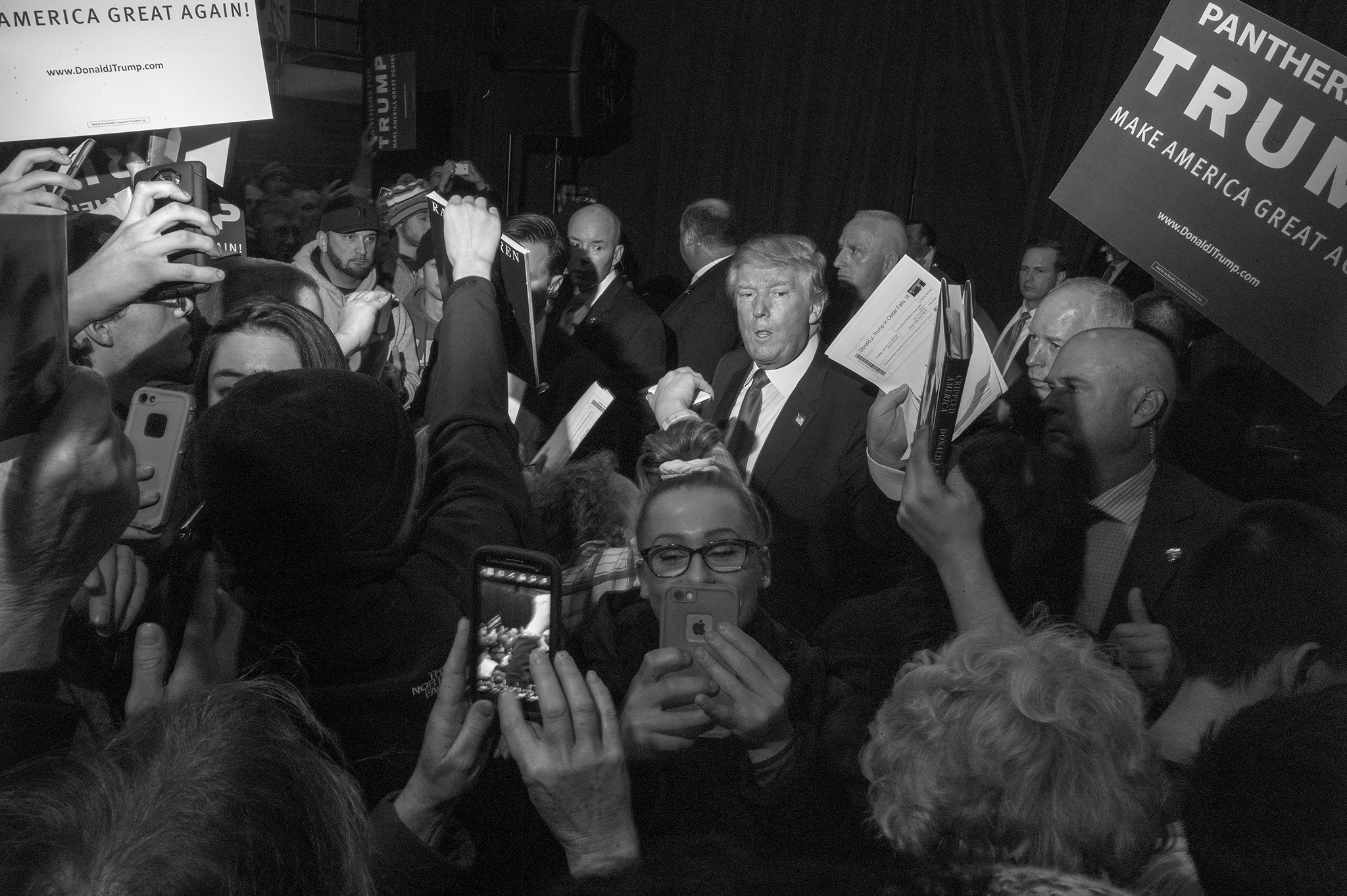 Supporters push and shove to get closer to Donald Trump after his rally at the University of Northern Iowa on Tuesday night.
