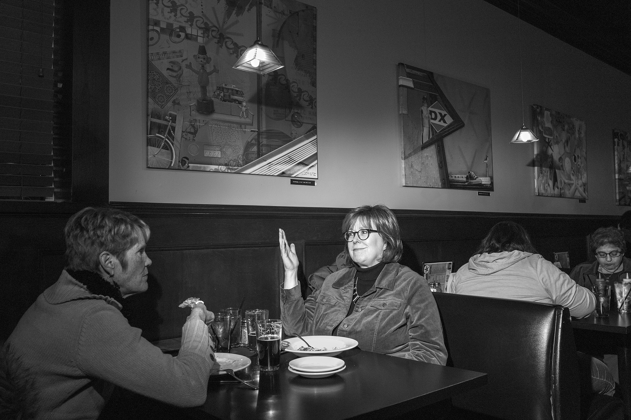 Selzer dines with a friend at the Star Bar in Des Moines on Jan. 17.