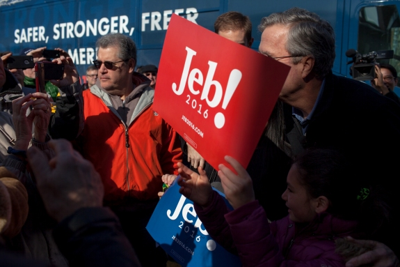 Jeb Bush meets with visitors and supporters outside the McKelvie Intermediate School in Bedford, New Hampshire, on Saturday.