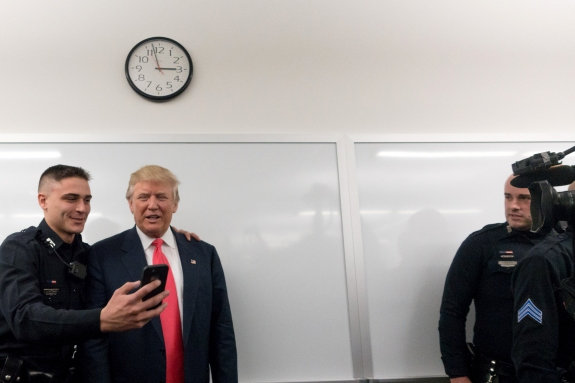 Donald Trump met with members of the Manchester Police Department during roll call at their headquarters in Manchester on Thursday.