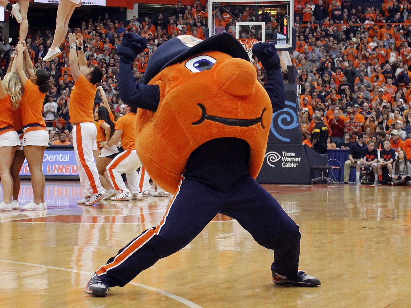 Otto the Orange, members of the Syracuse University cheerling team