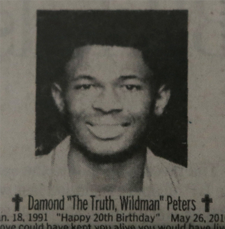 A newspaper clipping of the obituary for Damond Peters.