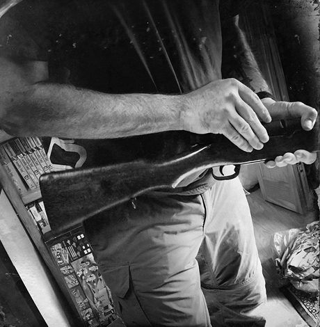 Guyse keeps several guns in a large safe in his home. This one is a Japanese training rifle that fires blanks.