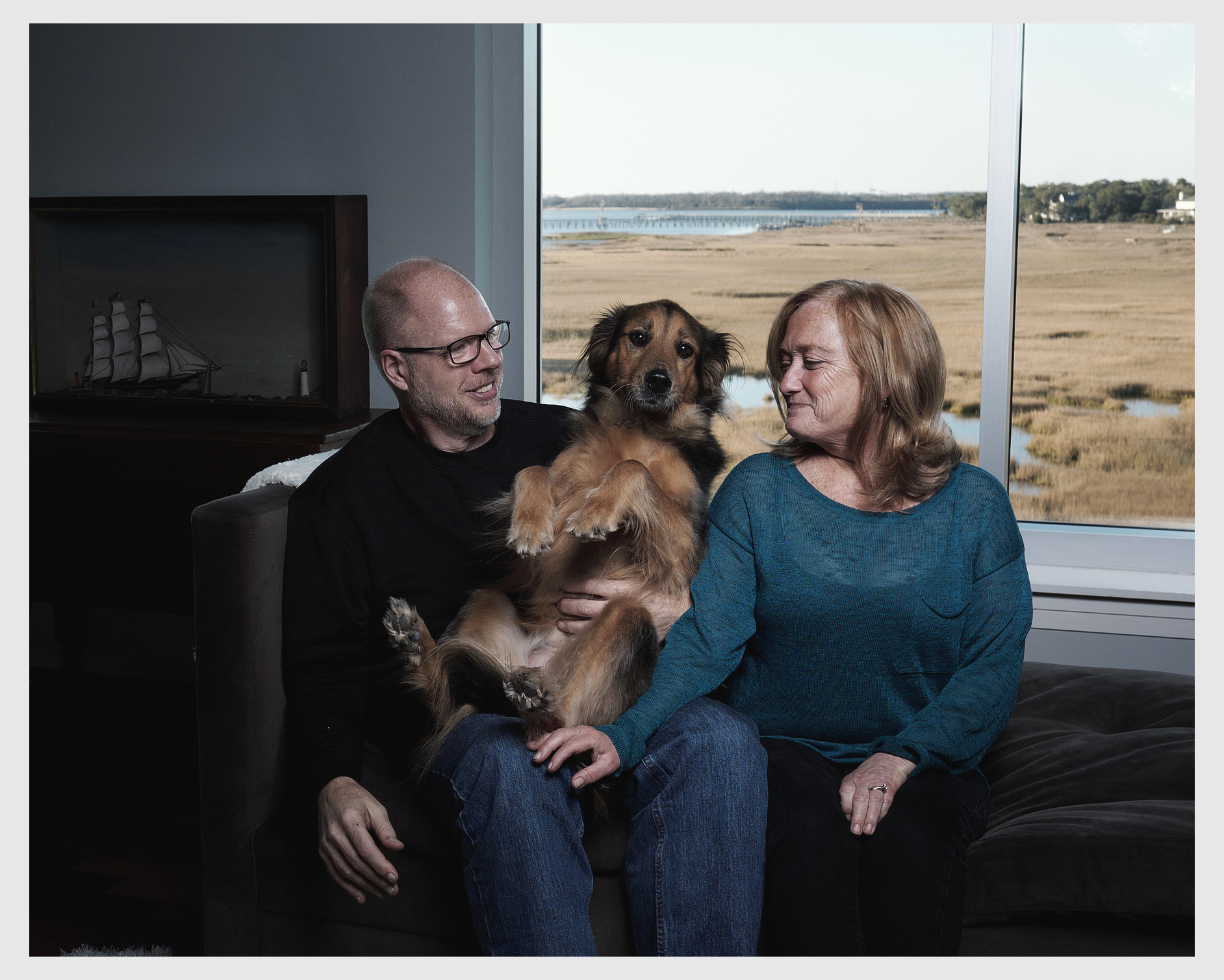 Chris and Kimarie Nickels, shown with their rescue dog Ripley, at their home in Mount Pleasant, South Carolina.