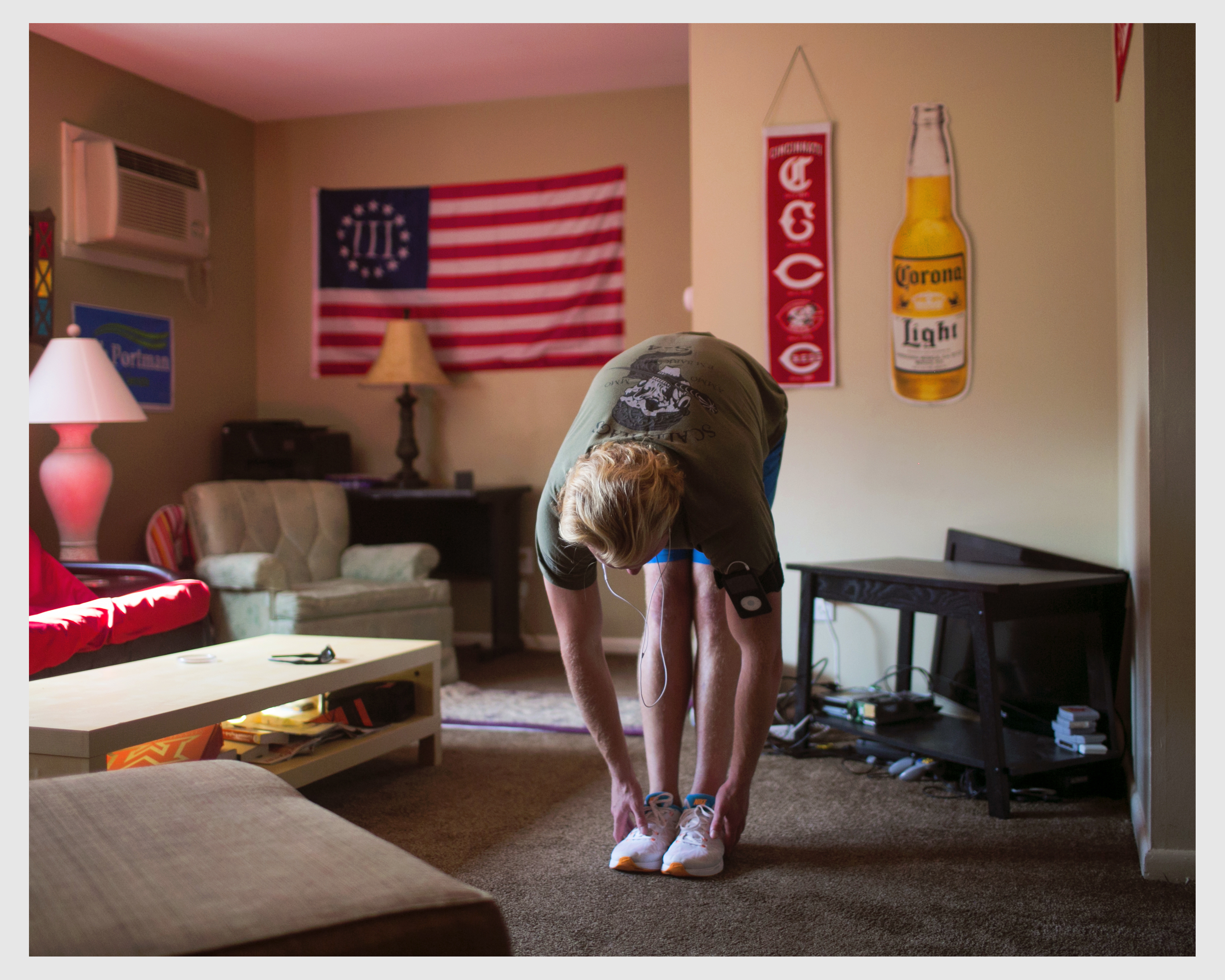Alexander Hale, 25, a philosophy major at Miami University of Ohio, stretches at his apartment before going for a jog on Aug. 26, 2016. Hale enlisted in the Marine Corps after high school and stays in shape so that he's eligible to rejoin the military if he chooses.
