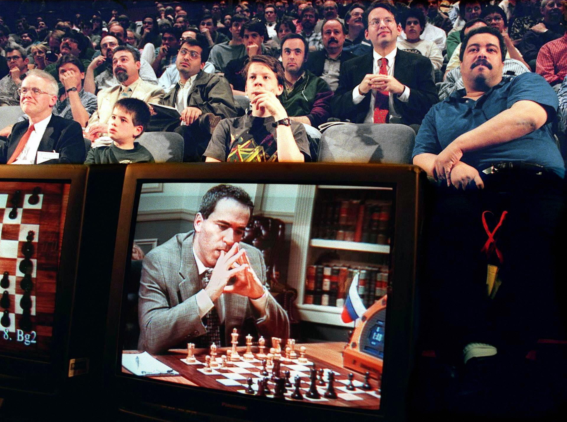 Fans watch a game Garry Kasparov and the IBM Deep Blue computer in 1997.