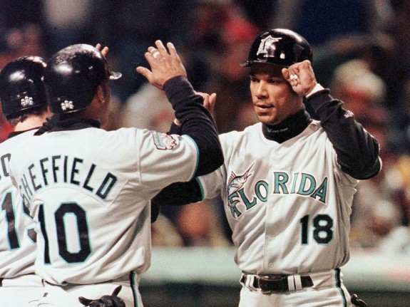 Florida Marlins Moises Alou (R) is congratulated b
