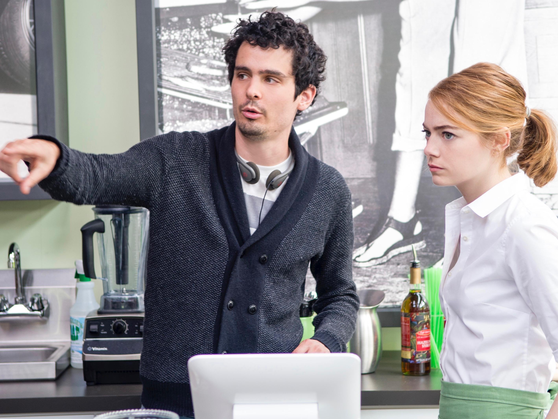 Director Damien Chazelle and Emma Stone on the set of LA LA LAND.