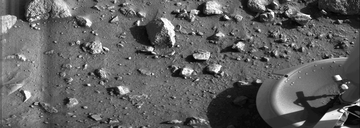 This is the first photograph ever taken on the surface of Mars, captured minutes after Viking 1 landed successfully on July 20, 1976.