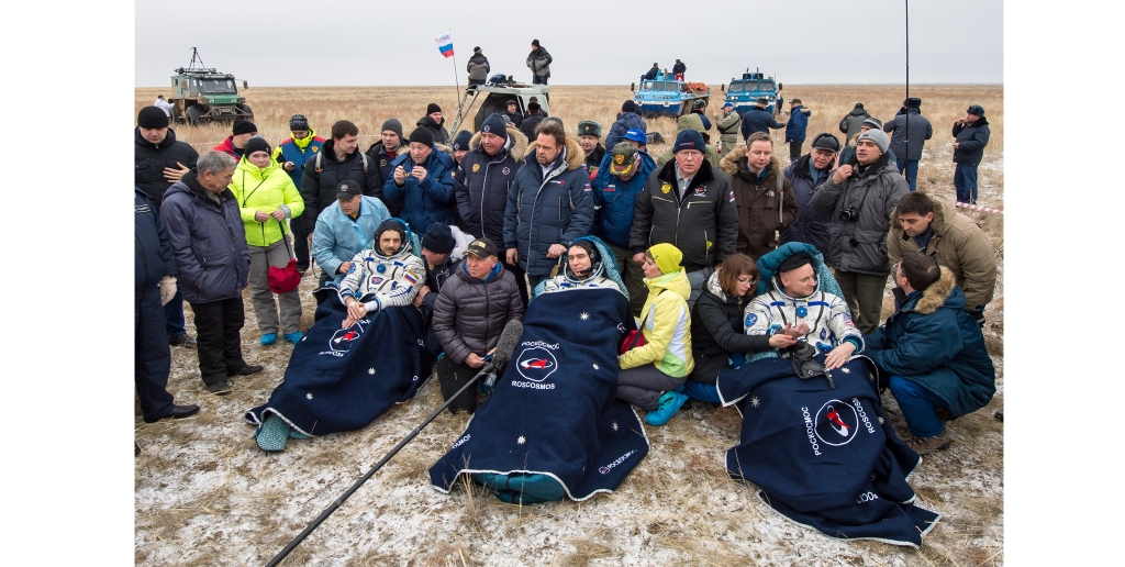 Russian cosmonauts Mikhail Kornienko, left, and Sergey Volkov of Roscosmos, center, and Expedition 46 Commander Scott Kelly of NASA rest in chairs minutes after they landed in a remote area of Kazakhstan on March 2, 2016. Kelly and Kornienko completed a record yearlong mission on the International Space Station to collect data on the effects of long-duration weightlessness on the human body. Volkov returned after spending six months on the station.