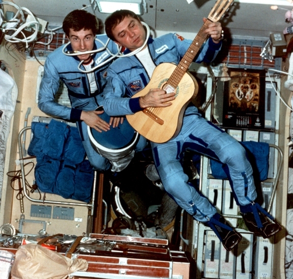 Cosmonauts Sergei Krikalev, left, and Alexander Volkov play music aboard Russia's Mir space station in 1989.