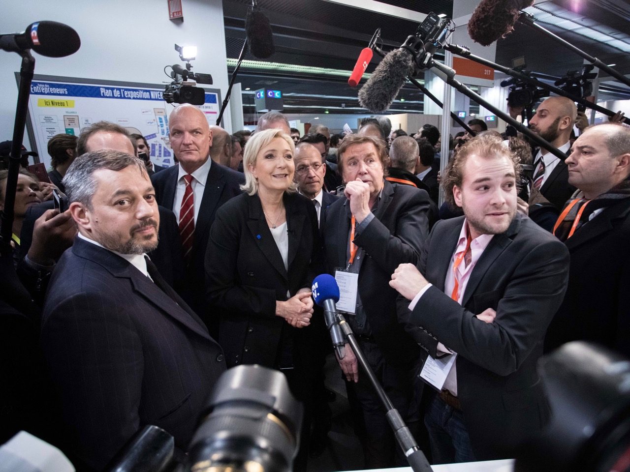 French far-right political Party National Front (FN) Leader Marine Le Pen's Press Visits le 'Salon des Entrepreneurs In Paris