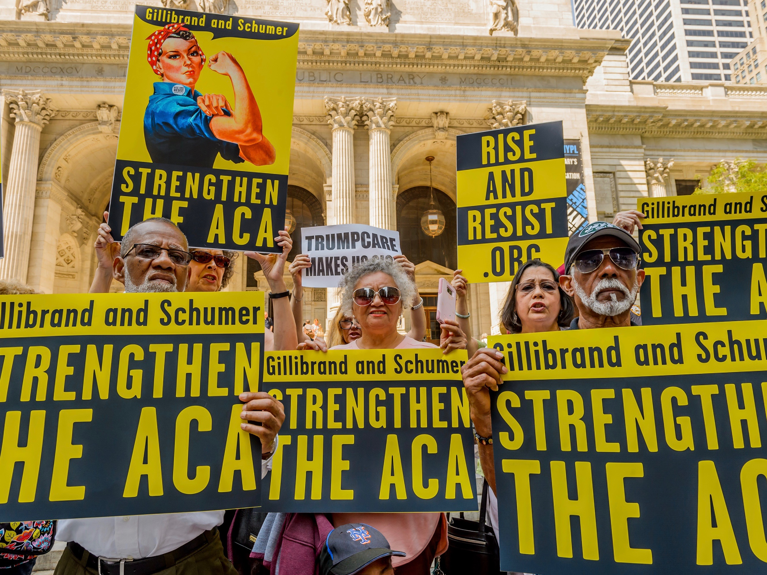 Activists marched to the offices of Senators Schumer and