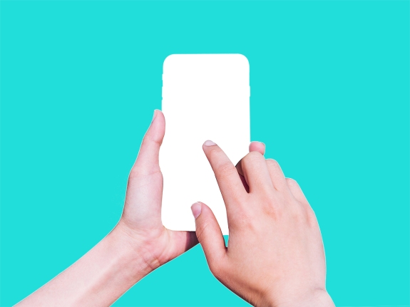 Cropped Hands Of Woman Using Mobile Phone Against White Background