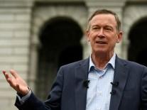 Former Colorado Governor John Hickenlooper addresses media about recent mass shootings.