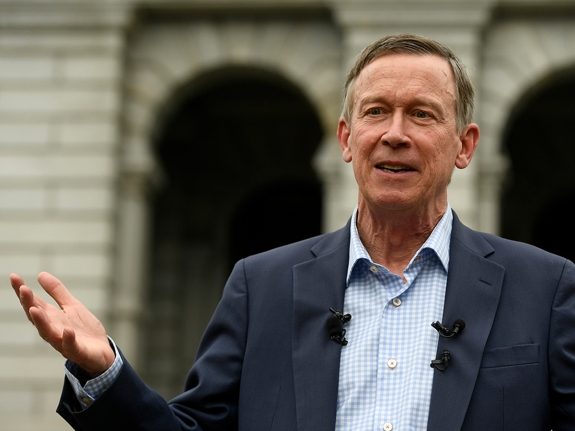 Former Colorado Governor John Hickenlooper addresses media about recent mass shootings.