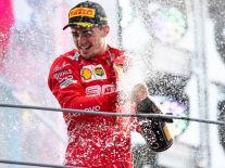 Charles Leclerc of Scuderia Ferrari celebrates on the podium