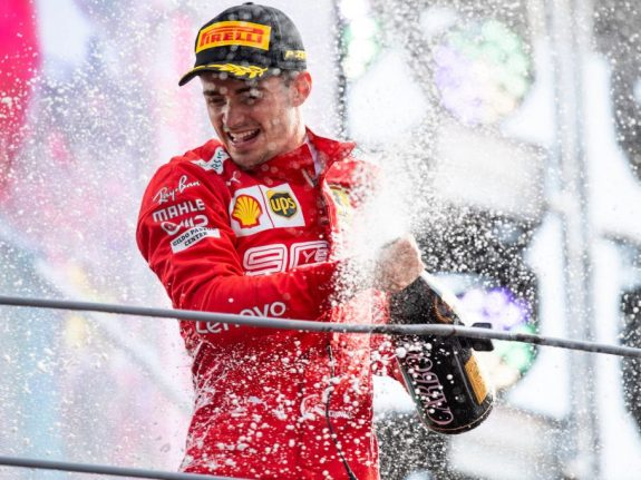 Charles Leclerc of Scuderia Ferrari celebrates on the podium