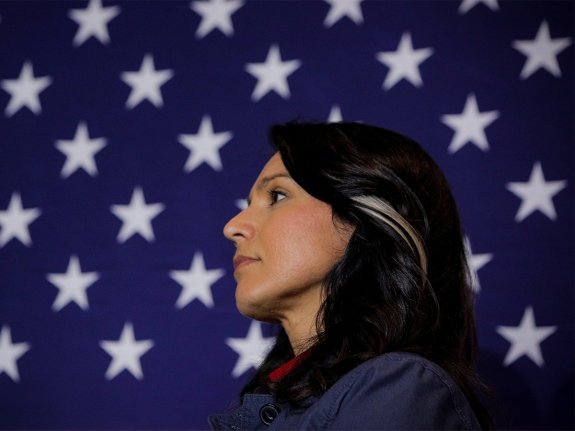 Democratic presidential candidate Rep. Tulsi Gabbard listens to a supporter during a campaign event in Lebanon, New Hampshire
