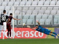 Andrea Belotti (2nd from L) of Torino FC scores a goal from