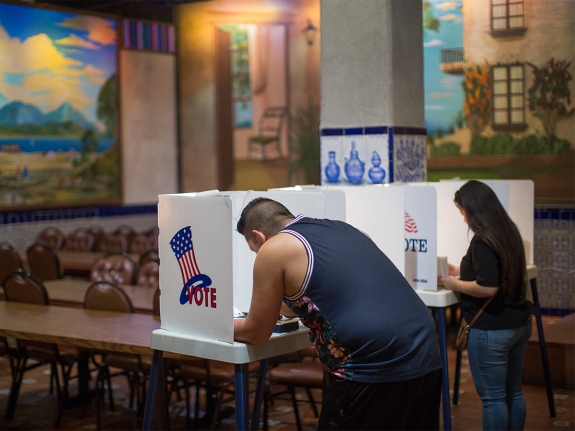 Latinos vote at a polling station in Los Angeles, California.